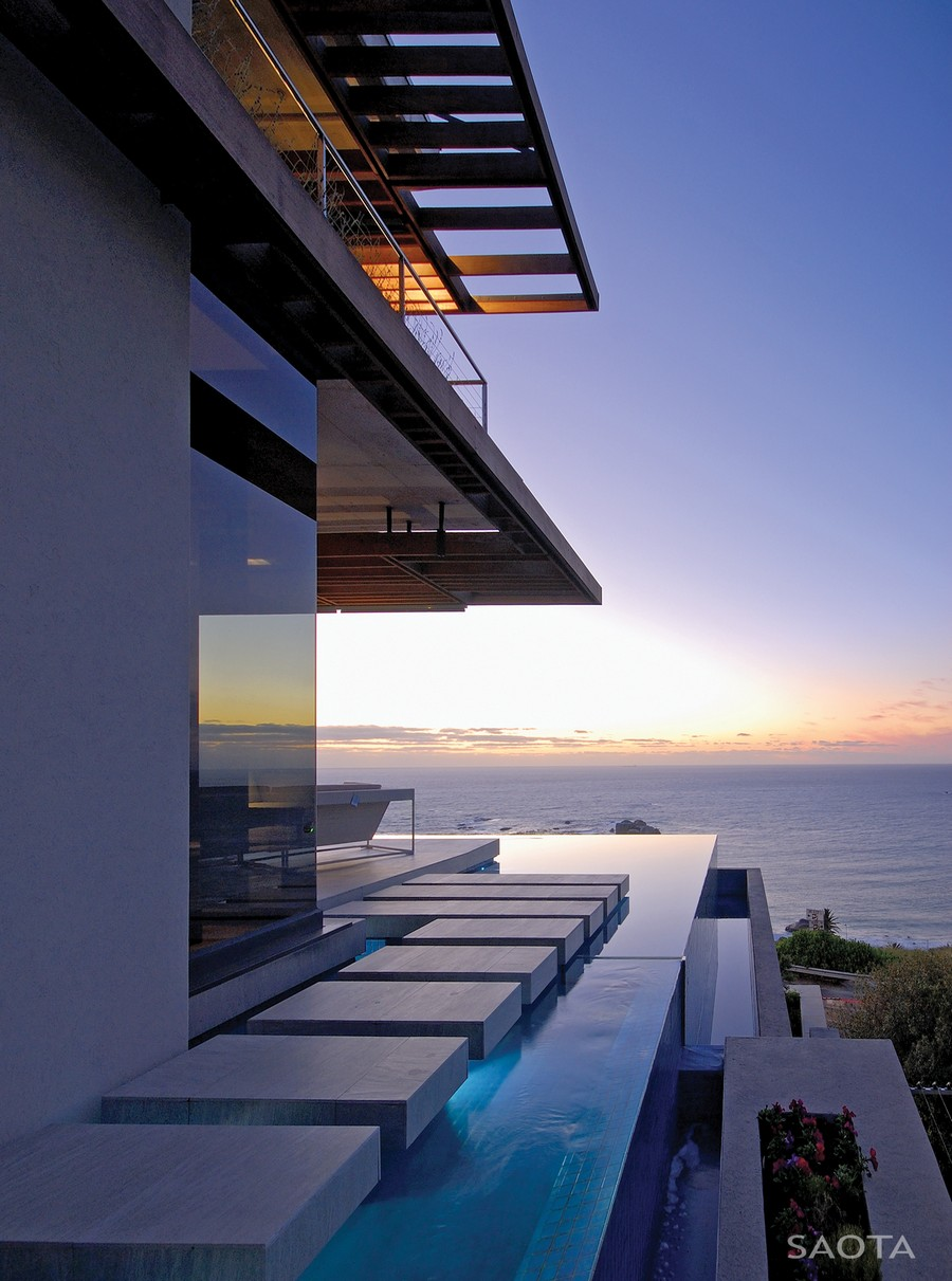 serene landscaping and expansive views overthe infinity swimming pool