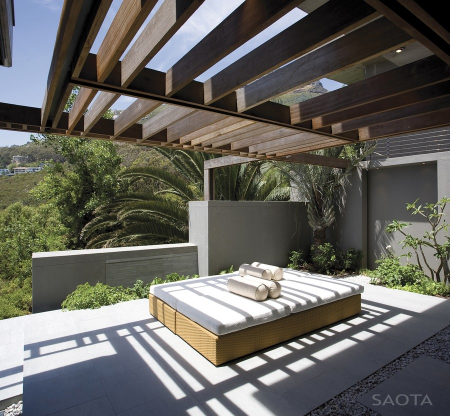 outdoor bed in the Personalized Modern Living in Cape Town SAOTA's Kloof 151 Project  South Africa