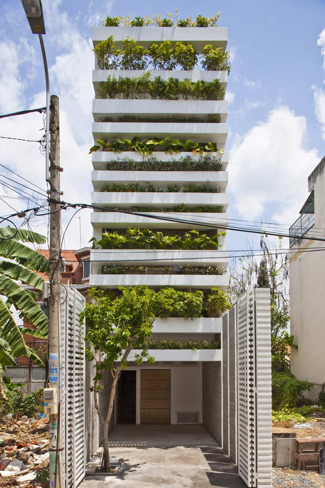 "green ""Stacking Green"" -Small House in Saigon Wearing Green Façades"