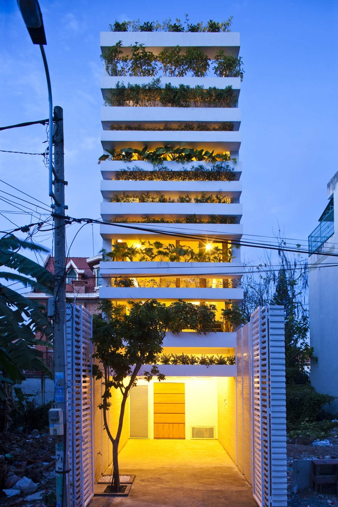 """Stacking Green"" -Small House in Saigon Wearing Green Façades at night"