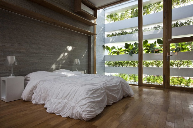 "green bedroom interior design ""Stacking Green"" -Small House in Saigon Wearing Green Façades"