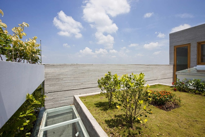 "superb view from the terrace of the ""Stacking Green"" -Small House in Saigon Wearing Green Façades"