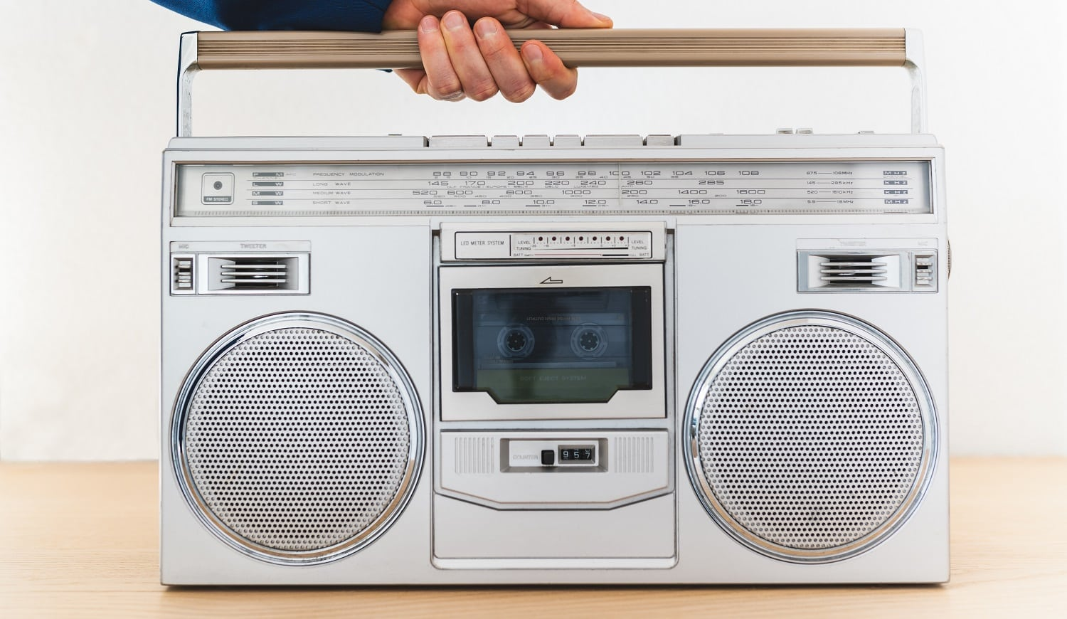 Image of Man Playing an Old Radio Indoors. Close Up of Vintage Radio. Man Using Cassette on Old Radio. Playing Music Indoors. Music Concept.