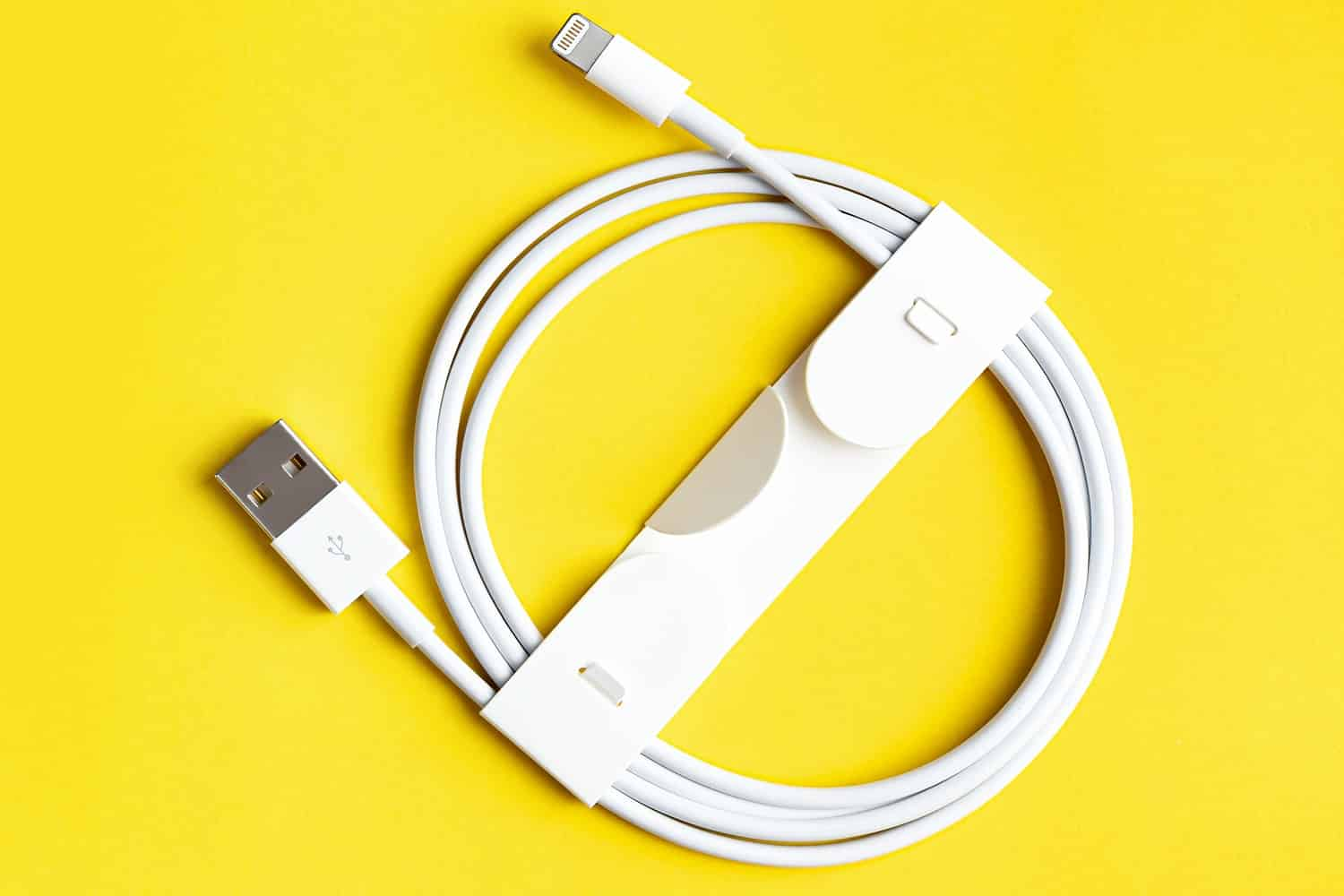 USB Charger for smartphone or tablet on yellow background