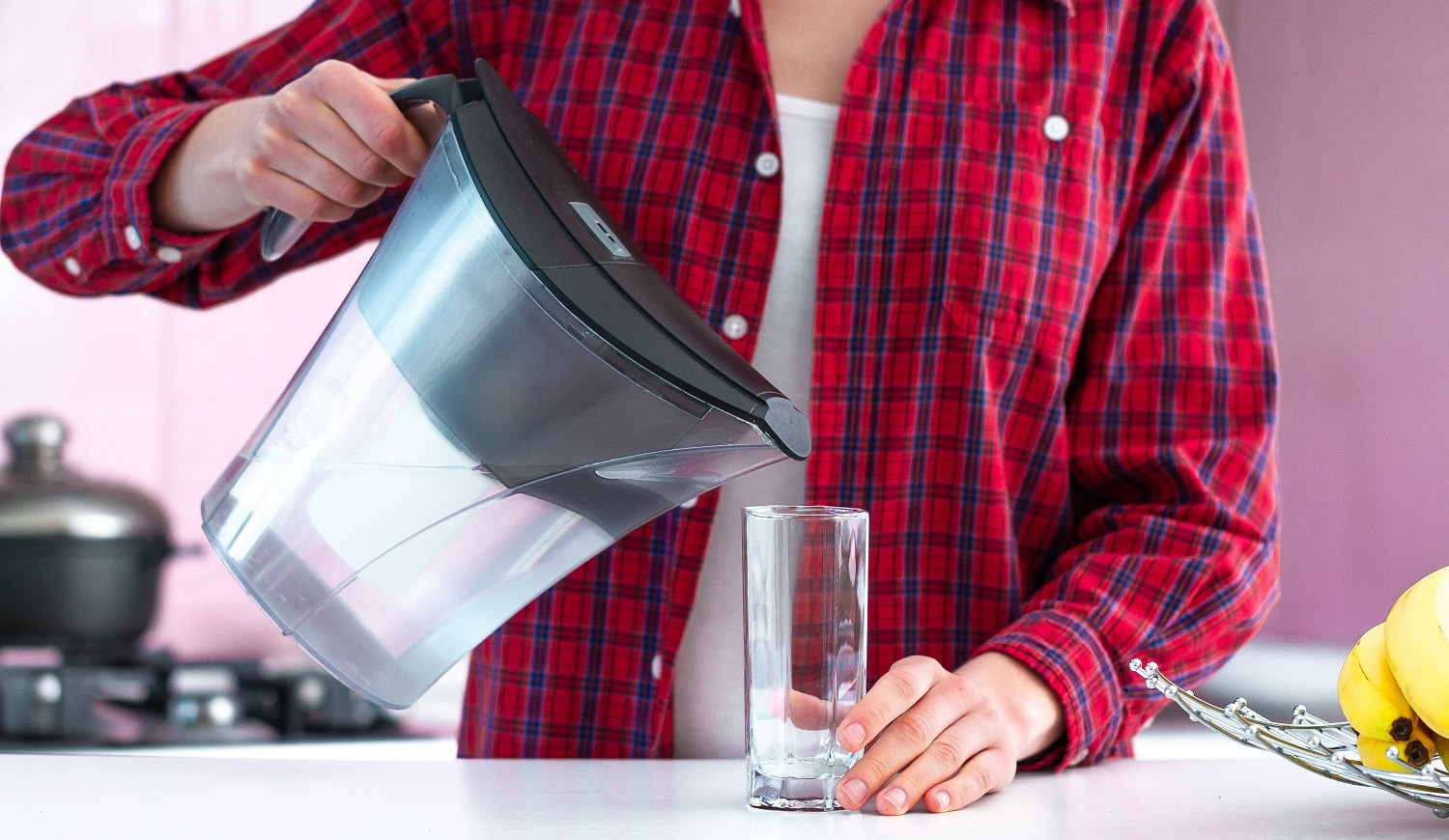 Fresh filtered water from water filter for drink. Healthy lifestyle. Water purification at home